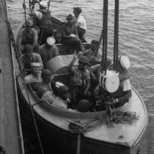 Closeup of sailors on boat being lowered into water